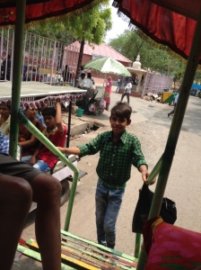 Boy selling us shoe covers to wear in Agra (cannot enter the Taj Mahal without them)